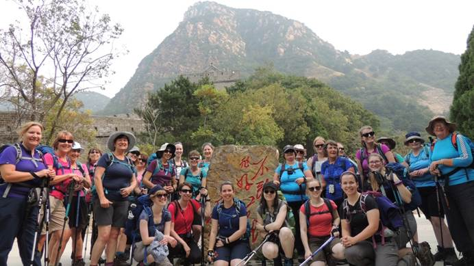 Group of Girlguiding China trekkers standing in front of a peak